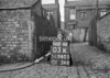 SD740503K, Man marking Ordnance Survey minor control revision point with an arrow in 1940s