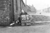 SD730520B, Man marking Ordnance Survey minor control revision point with an arrow in 1940s