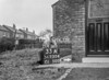 SD730433A, Man marking Ordnance Survey minor control revision point with an arrow in 1940s