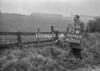 SD740375W, Man marking Ordnance Survey minor control revision point with an arrow in 1940s