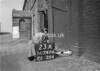SD740423A, Man marking Ordnance Survey minor control revision point with an arrow in 1940s