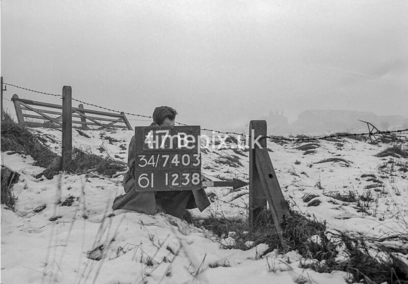 SD740347B, Man marking Ordnance Survey minor control revision point with an arrow in 1940s