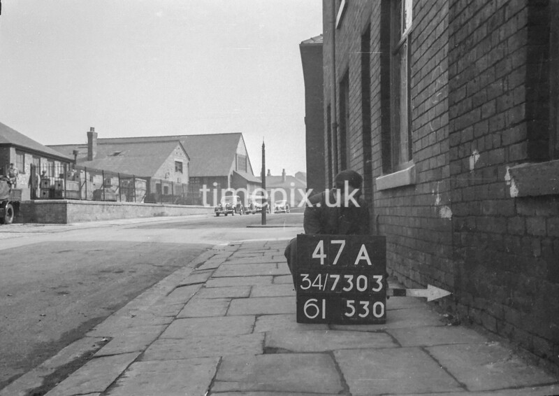 SD730347A, Man marking Ordnance Survey minor control revision point with an arrow in 1940s