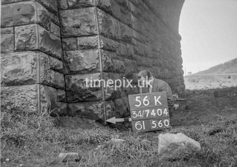 SD740456K, Man marking Ordnance Survey minor control revision point with an arrow in 1940s
