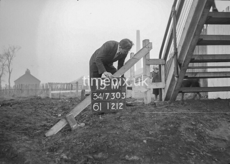SD730315W, Man marking Ordnance Survey minor control revision point with an arrow in 1940s