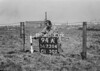 SD730494A, Man marking Ordnance Survey minor control revision point with an arrow in 1940s