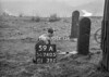 SD740559A, Man marking Ordnance Survey minor control revision point with an arrow in 1940s