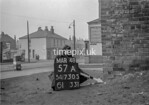 SD730557A, Man marking Ordnance Survey minor control revision point with an arrow in 1940s