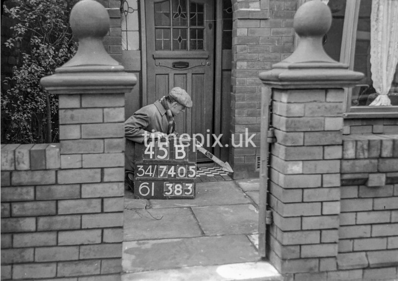 SD740545B, Man marking Ordnance Survey minor control revision point with an arrow in 1940s