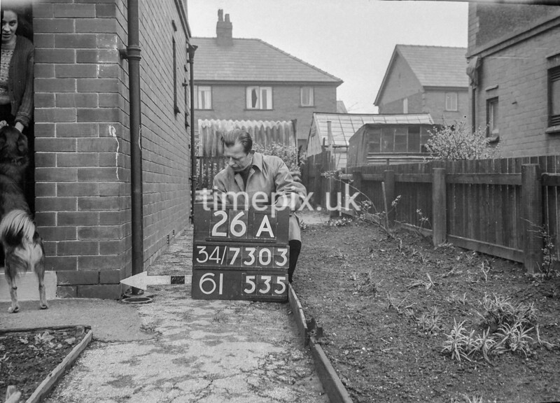 SD730326A, Man marking Ordnance Survey minor control revision point with an arrow in 1940s