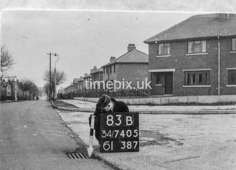 SD740583B1, Man marking Ordnance Survey minor control revision point with an arrow in 1940s