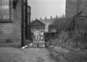 SD730533A, Man marking Ordnance Survey minor control revision point with an arrow in 1940s