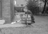 SD740487B, Man marking Ordnance Survey minor control revision point with an arrow in 1940s
