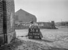 SD740436A, Man marking Ordnance Survey minor control revision point with an arrow in 1940s
