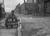 SD740549R, Man marking Ordnance Survey minor control revision point with an arrow in 1940s