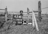 SD740442A, Man marking Ordnance Survey minor control revision point with an arrow in 1940s