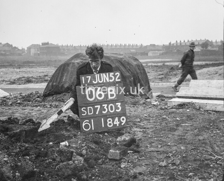 SD730306A, Man marking Ordnance Survey minor control revision point with an arrow in 1950s