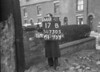 SD730517B, Man marking Ordnance Survey minor control revision point with an arrow in 1940s