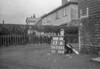 SD730513A, Man marking Ordnance Survey minor control revision point with an arrow in 1940s