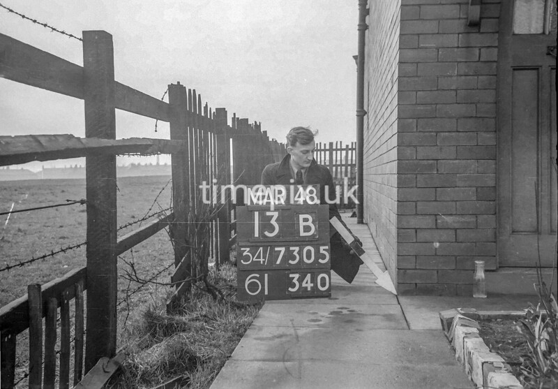 SD730513B, Man marking Ordnance Survey minor control revision point with an arrow in 1940s