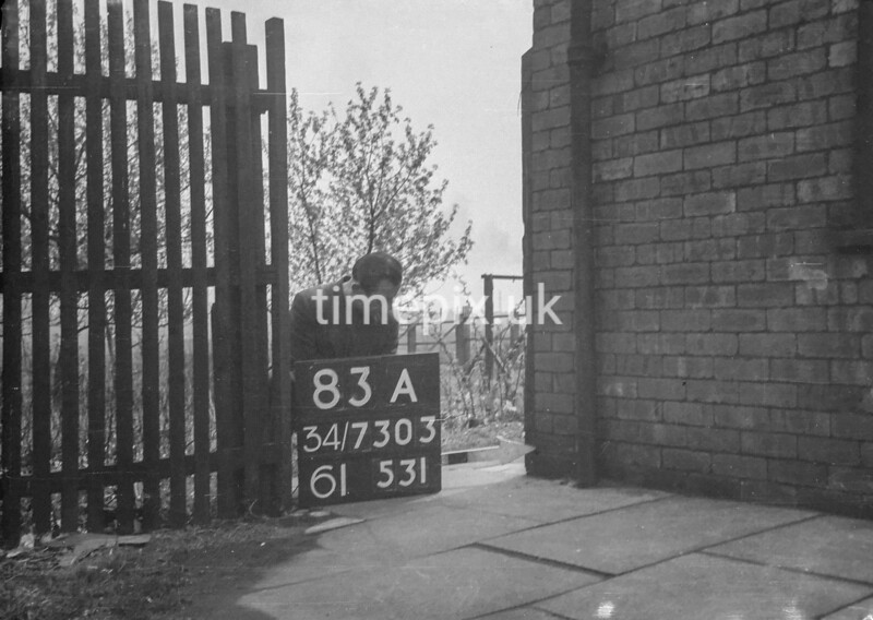 SD730383A, Man marking Ordnance Survey minor control revision point with an arrow in 1940s