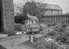 SD730434B, Man marking Ordnance Survey minor control revision point with an arrow in 1940s