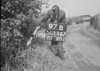 SD730397B, Man marking Ordnance Survey minor control revision point with an arrow in 1940s