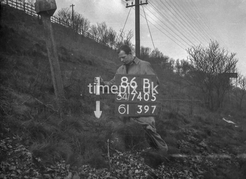 SD740586B, Man marking Ordnance Survey minor control revision point with an arrow in 1940s