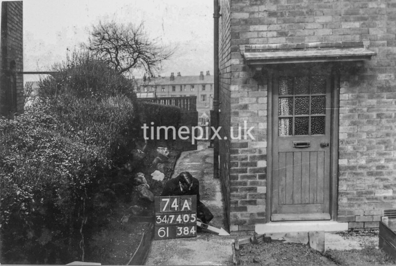 SD740574A1, Man marking Ordnance Survey minor control revision point with an arrow in 1940s
