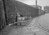 SD740549A, Man marking Ordnance Survey minor control revision point with an arrow in 1940s
