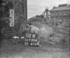 SD730402B, Man marking Ordnance Survey minor control revision point with an arrow in 1940s