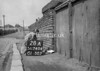 SD740428A, Man marking Ordnance Survey minor control revision point with an arrow in 1940s