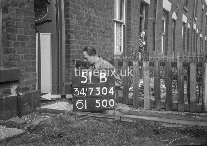 SD730451B, Man marking Ordnance Survey minor control revision point with an arrow in 1940s