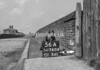 SD740456A, Man marking Ordnance Survey minor control revision point with an arrow in 1940s
