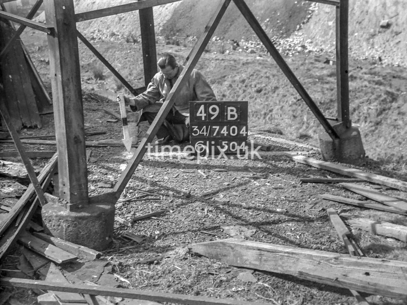 SD740449B, Man marking Ordnance Survey minor control revision point with an arrow in 1940s