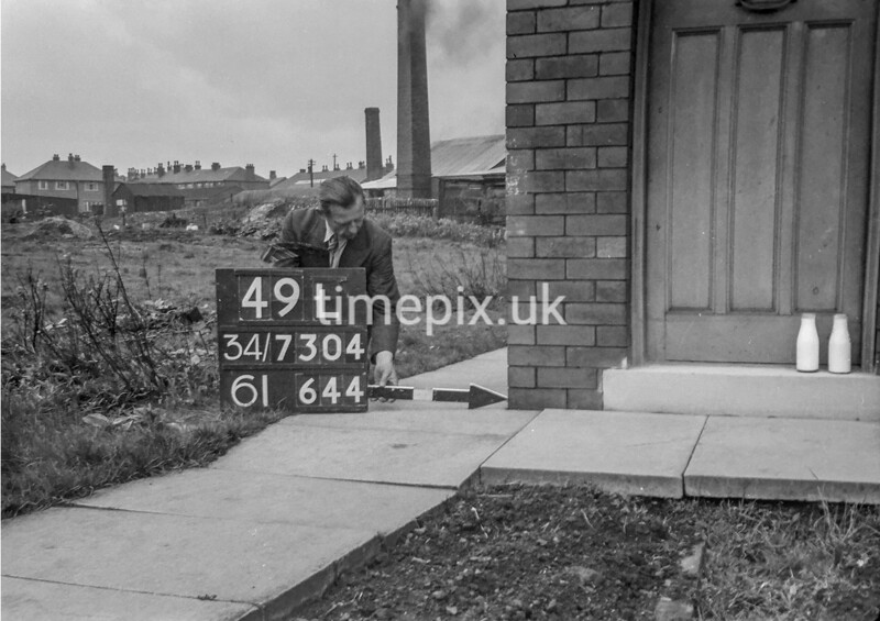 SD730449L, Man marking Ordnance Survey minor control revision point with an arrow in 1940s