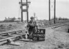 SD740375A, Man marking Ordnance Survey minor control revision point with an arrow in 1940s