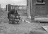 SD740486A, Man marking Ordnance Survey minor control revision point with an arrow in 1940s