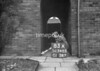 SD740583A, Man marking Ordnance Survey minor control revision point with an arrow in 1940s