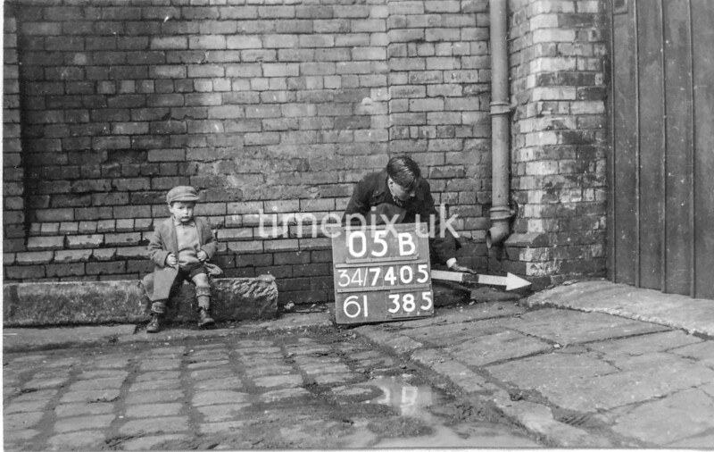 SD740505B1, Man marking Ordnance Survey minor control revision point with an arrow in 1940s
