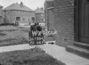 SD730419A, Man marking Ordnance Survey minor control revision point with an arrow in 1940s