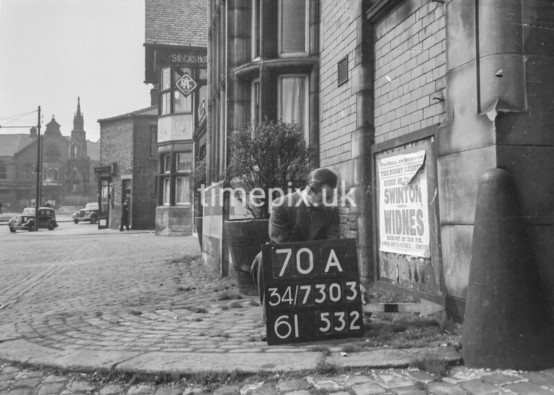 SD730370A, Man marking Ordnance Survey minor control revision point with an arrow in 1940s