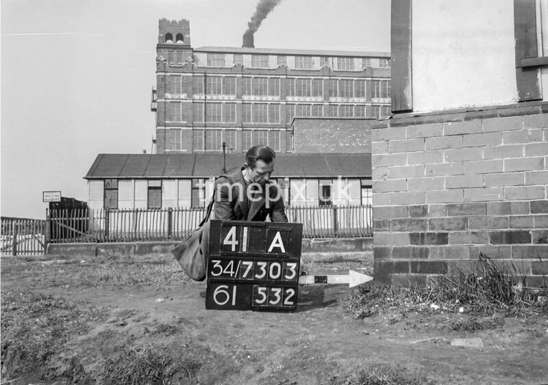 SD730341A, Man marking Ordnance Survey minor control revision point with an arrow in 1940s