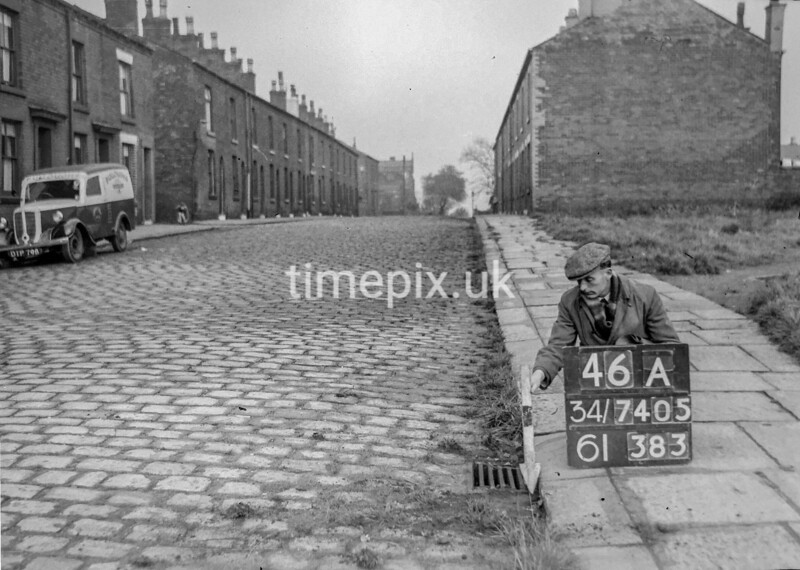 SD740546A, Man marking Ordnance Survey minor control revision point with an arrow in 1940s