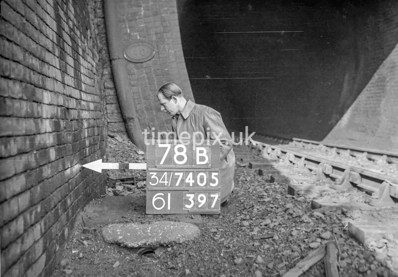 SD740578B, Man marking Ordnance Survey minor control revision point with an arrow in 1940s