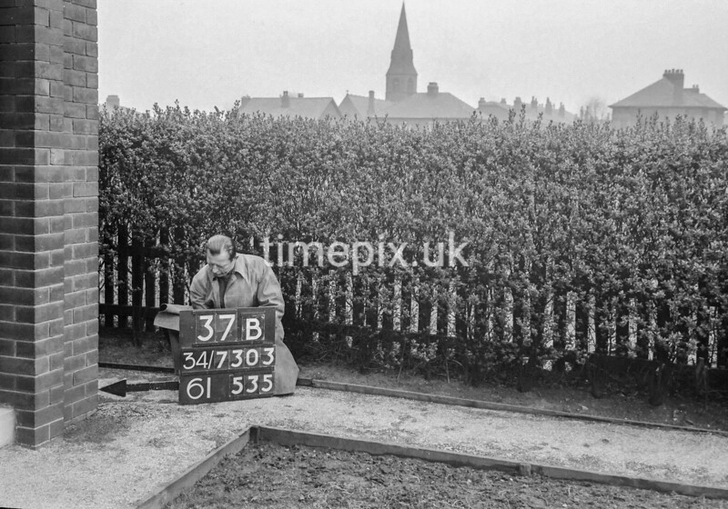 SD730337B, Man marking Ordnance Survey minor control revision point with an arrow in 1940s