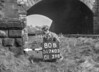 SD740580B, Man marking Ordnance Survey minor control revision point with an arrow in 1940s