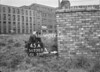SD730345A1, Man marking Ordnance Survey minor control revision point with an arrow in 1940s