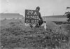 SD740329A, Man marking Ordnance Survey minor control revision point with an arrow in 1940s