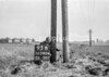 SD740493B, Man marking Ordnance Survey minor control revision point with an arrow in 1940s